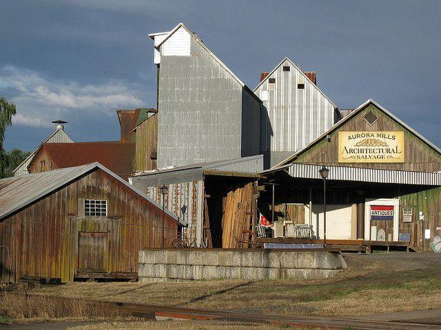 """<p>Only 25 minutes from Portland is this antique-filled town, which was originally founded as a <a href=""""http://auroracolony.com/wp/about/"""" rel=""""nofollow noopener"""" target=""""_blank"""" data-ylk=""""slk:Utopian society"""" class=""""link rapid-noclick-resp"""">Utopian society</a>. Now, it's a utopia of <a href=""""http://auroracolony.com/wp/shops-services/"""" rel=""""nofollow noopener"""" target=""""_blank"""" data-ylk=""""slk:dozens of antique, vintage, and specialty shops"""" class=""""link rapid-noclick-resp"""">dozens of antique, vintage, and specialty shops</a>. </p><p><a href=""""https://flic.kr/p/6YrxtM"""" rel=""""nofollow noopener"""" target=""""_blank"""" data-ylk=""""slk:Photo via Flickr"""" class=""""link rapid-noclick-resp""""><em>Photo via Flickr </em></a></p>"""