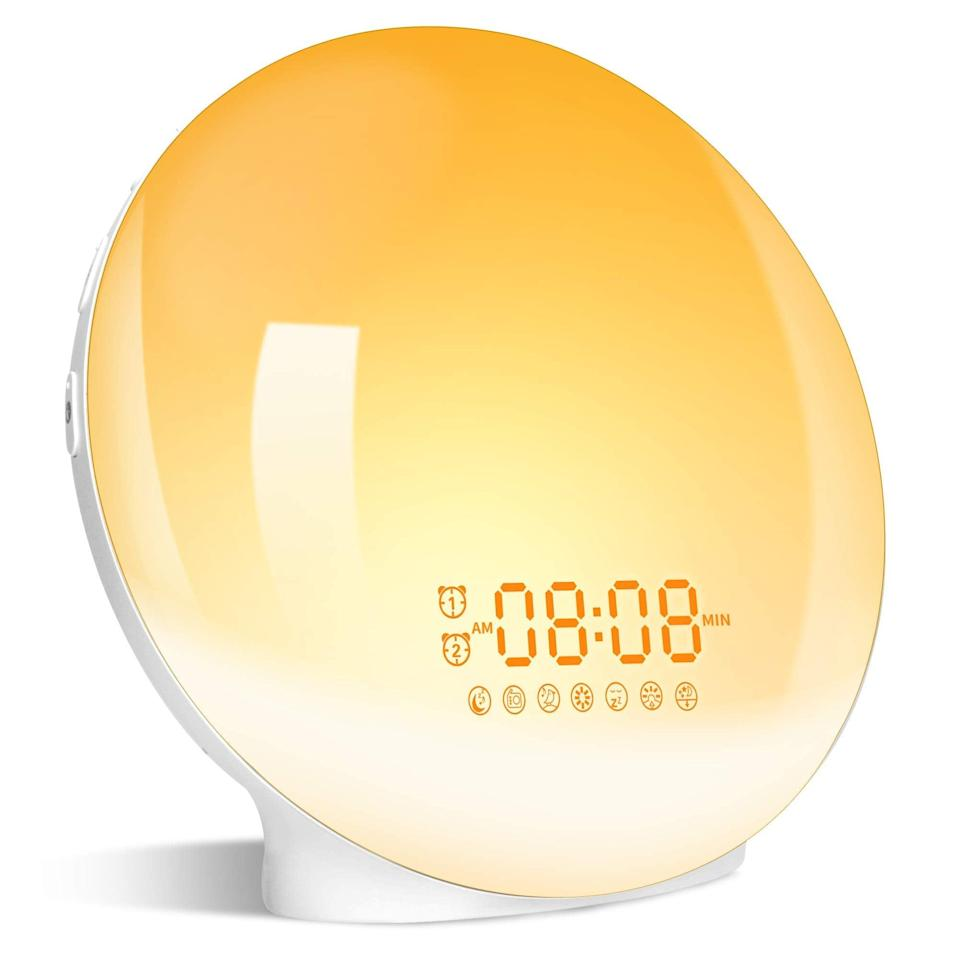 """<h3>Sunrise Alarm Clock </h3><br>Instead of being jolted awake by an iPhone's siren sound, readers opted for this <a href=""""https://www.refinery29.com/en-us/2018/11/215874/light-alarm-clock"""" rel=""""nofollow noopener"""" target=""""_blank"""" data-ylk=""""slk:sunrise clock"""" class=""""link rapid-noclick-resp"""">sunrise clock</a> that works by using a gradually-brightening light to <a href=""""https://www.refinery29.com/en-us/sad-lamps-lights"""" rel=""""nofollow noopener"""" target=""""_blank"""" data-ylk=""""slk:simulate sunlight"""" class=""""link rapid-noclick-resp"""">simulate sunlight</a> for a natural wake process — and it's currently 30% off just in time for the days to get darker and drearier. <br><br><strong>4.5 out of 5 stars and 3,541 reviews</strong><br><br><strong>LBell</strong> Wake-Up Light, Sunrise Simulation & Sleep Aid Alarm, $, available at <a href=""""https://amzn.to/3nKjZ5T"""" rel=""""nofollow noopener"""" target=""""_blank"""" data-ylk=""""slk:Amazon"""" class=""""link rapid-noclick-resp"""">Amazon</a>"""