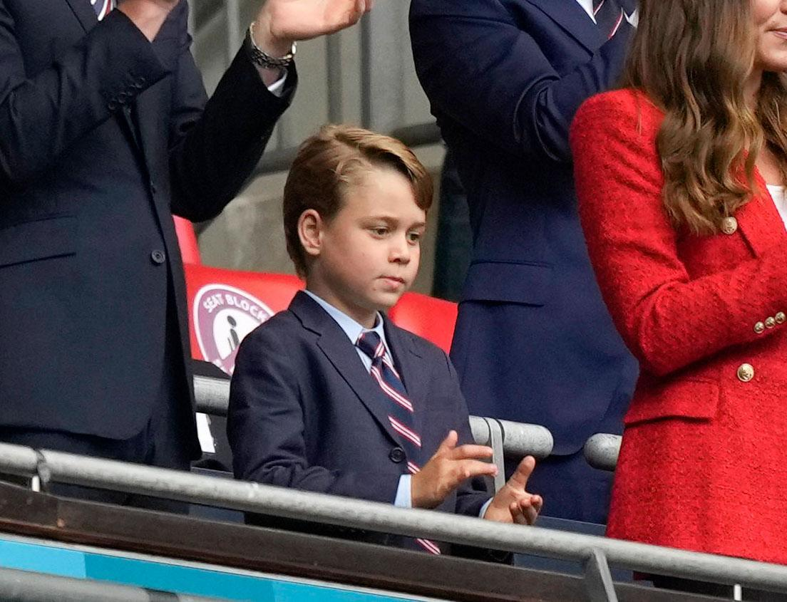 George applauding before the start of the match