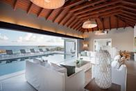 """This home has nailed indoor-outdoor living, with floor-to-ceiling glass pocket doors that fold away to open up the entire living room to the heated lap pool and deck, with views over Anse de Marigot, a beach known for its calm, clear waters and snorkeling. There's also a private plunge pool off one of the bedrooms. Speaking of bedrooms, there are five spread across this villa, all with their own ensuite bathrooms, in addition to the home's fitness room and home theater for movie nights after long days in the sun. Book a stay here and you'll also have a chauffeured transfer to and from the airport, as well as daily housekeeping. Coordinate with the house's management after booking to schedule a private chef and yacht reservations at an additional cost. <em>(From 289,000 points per night)</em> $1734, Marriott. <a href=""""https://homes-and-villas.marriott.com/en/properties/78074769-saint-barthelemy-tremendously-gorgeous-villa-with-magnificent-views"""" rel=""""nofollow noopener"""" target=""""_blank"""" data-ylk=""""slk:Get it now!"""" class=""""link rapid-noclick-resp"""">Get it now!</a>"""