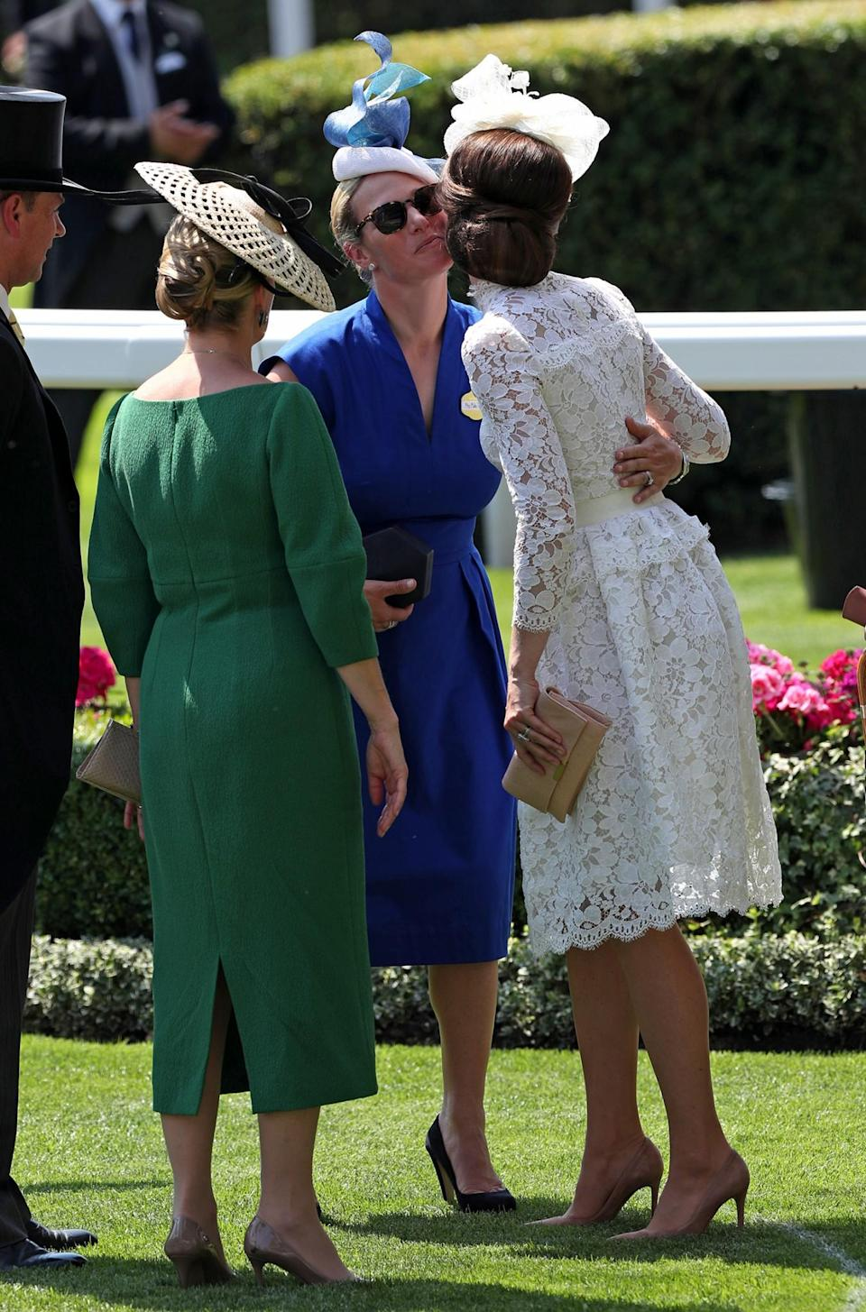 <p>Zara added a pop of colour to the family's fashion offering in a royal blue belted dress by Escada, paired with an artistic hat. <br><em>[Photo: Getty]</em> </p>