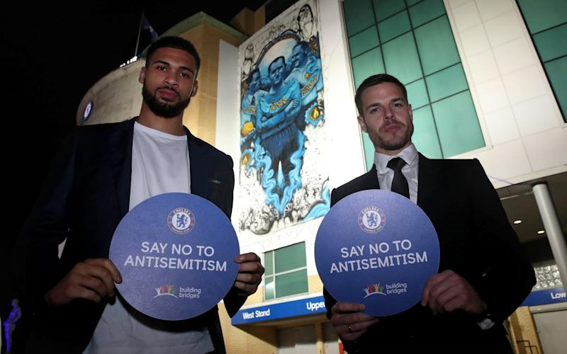 Ruben Loftus-Cheek (left) and Cezar Azpilicueta stand in front of the giant mural on the side of Stamford Bridge - Chelsea FC