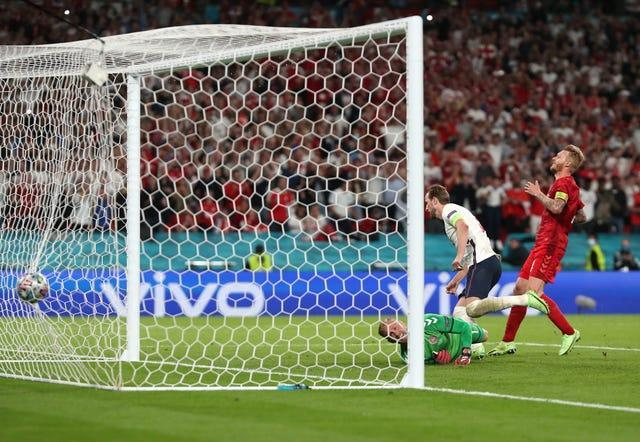 Harry Kane scores from the rebound of his saved penalty