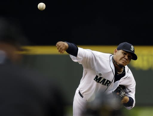 Seattle Mariners starting pitcher Felix Hernandez (34) throws in the third inning of a baseball game against the Los Angeles Angels, Saturday, April 27, 2013, in Seattle. (AP Photo/Ted S. Warren)