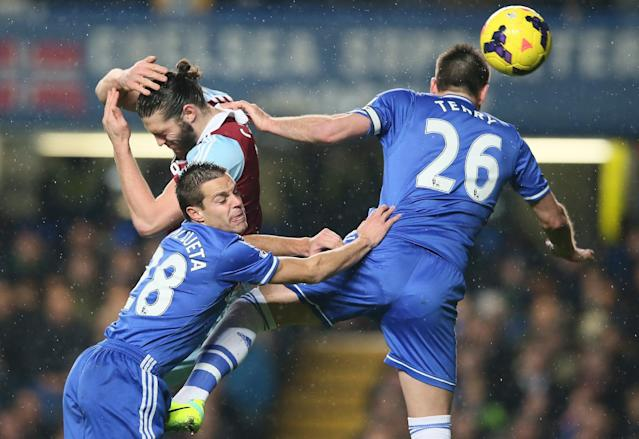 FILE - In this Wednesday, Jan. 29, 2014 file photo, Chelsea's John Terry, right heads the ball under pressure from West Ham United's Andy Carroll, top left, who avoids Chelsea's Cesar Azpilicueta during the English Premier League soccer match at Stamford Bridge stadium in London. British Sky Broadcasting PLC sought Thursday Jan. 30, 2014 to secure its base against its insurgent rival BT PLC by securing some sports rights and a long-term deal with U.S. pay-TV network Home Box Office. Soon, the bids are due for the next round of Premier League rights and if recent events are anything to go by, the cost is likely to rise, and quite substantially. The last set of domestic three-year rights generated a total of a little more than 3 billion pounds, with BSkyB splashing out 1.78 billion pounds for a majority of the matches on offer. (AP Photo/Alastair Grant, File)