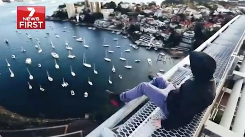 Trespassing onto some of Sydney's highest bridges and buildings, the fame-seeking youngsters are causing a stir with their high-risk images. Source: 7 News