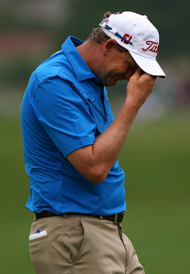 IRVING, TX - MAY 17:  Tom Gillis reacts after missing a birdie putt during the second round of the 2013 HP Byron Nelson Championship at the TPC Four Seasons Resort on May 17, 2013 in Irving, Texas.  (Photo by Tom Pennington/Getty Images)