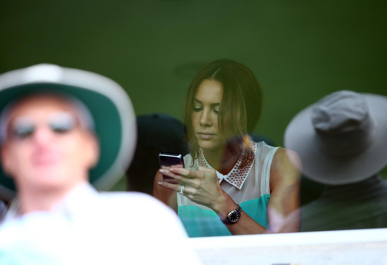 BRISBANE, AUSTRALIA - NOVEMBER 09:  Kyly Clarke, wife of Michael Clarke of Australia, looks on during day one of the First Test match between Australia and South Africa at The Gabba on November 9, 2012 in Brisbane, Australia.  (Photo by Ryan Pierse/Getty Images)