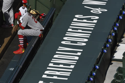 St. Louis Cardinals center fielder Dexter Fowler (25) sits in the dugout during the first inning of Game 1 of a baseball doubleheader against the Chicago Cubs, Monday, Aug. 17, 2020, in Chicago. (AP Photo/Matt Marton)