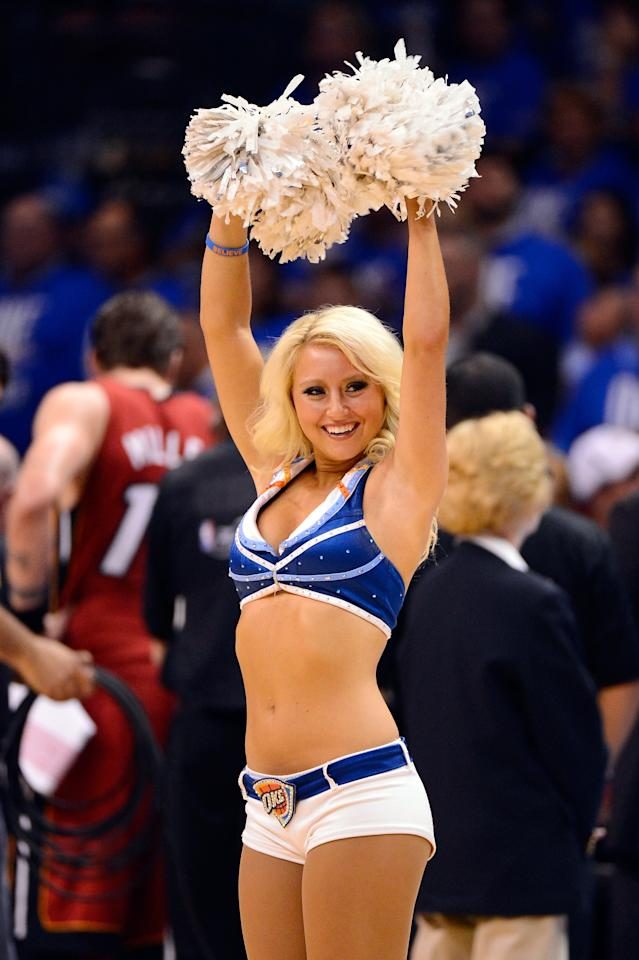 OKLAHOMA CITY, OK - JUNE 12:  An Oklahoma City Thunder dancer performs during a break in the game against the Miami Heat in Game One of the 2012 NBA Finals at Chesapeake Energy Arena on June 12, 2012 in Oklahoma City, Oklahoma. NOTE TO USER: User expressly acknowledges and agrees that, by downloading and or using this photograph, User is consenting to the terms and conditions of the Getty Images License Agreement.  (Photo by Ronald Martinez/Getty Images)