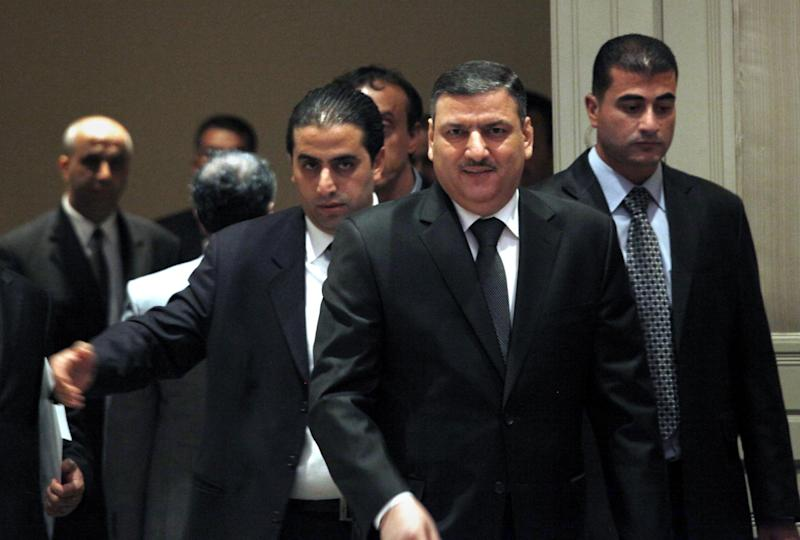 Riad Hijab, Syria's defected former prime minister arrives to a press conference at the Hyatt Hotel, in Amman, Jordan, Tuesday, Aug. 14, 2012. Hijab is the highest-ranking political figure to defect from Assad's regime and in his first public comments since leaving his post and fleeing to Jordan he said Tuesday that the regime was near collapse and urged other political and military leaders to tip the scales and join the rebel side. (AP photo/Mohammad Hannon)
