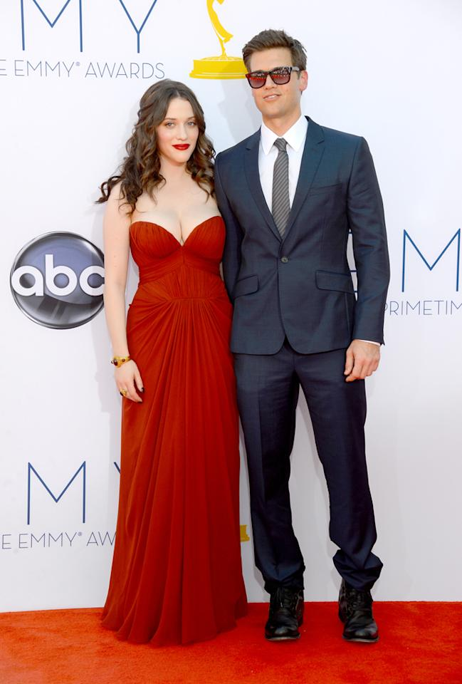 Kat Dennings and Nick Zano at the 64th Primetime Emmy Awards at the Nokia Theatre in Los Angeles on September 23, 2012.