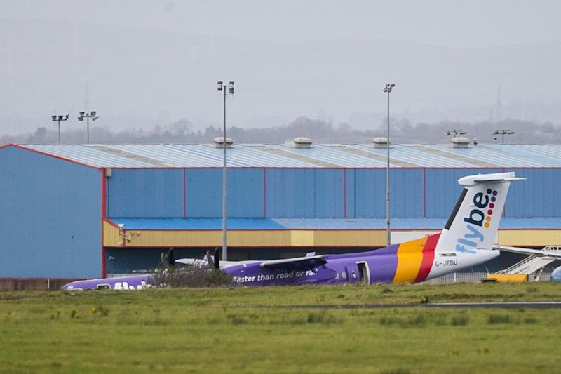 Flybe BE331 on the tarmac after it landed with no nose gear at Belfast International Airport: PA