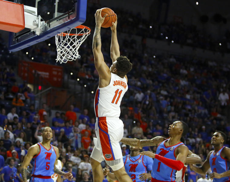 Florida guard Keyontae Johnson (11) goes up for a dunk against Mississippi during an NCAA college basketball game Tuesday, Jan. 14, 2020, in Gainesville, Fla. (Brad McClenny/The Gainesville Sun via AP)