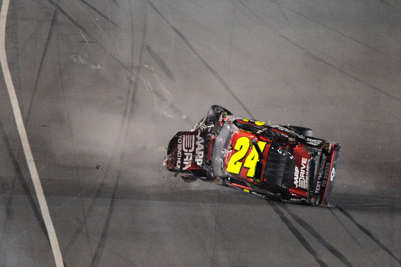 Jeff Gordon rolls after a crash coming out of Turn 4 during the NASCAR Budweiser Shootout auto race at Daytona International Speedway, Saturday, Feb. 18, 2012, in Daytona Beach, Fla. (AP Photo/Phelan M. Ebenhack)