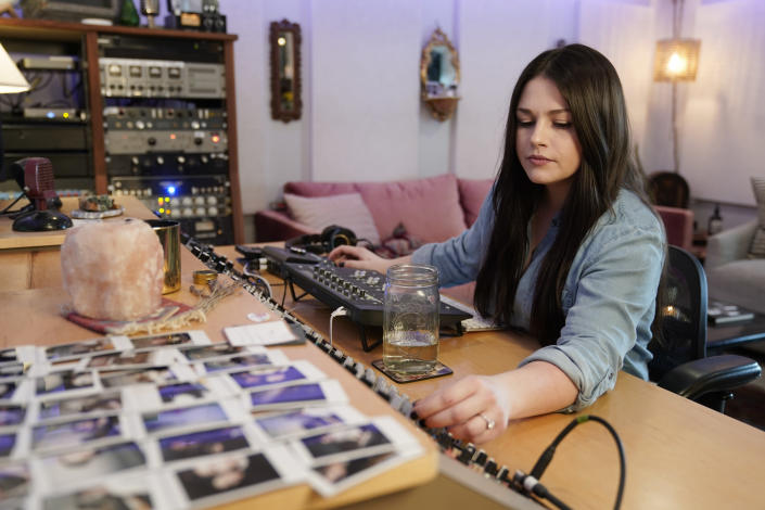 Gena Johnson works in her home studio in Nashville, Tenn. on April 8, 2021. Johnson, a recording engineer, is the first woman to ever be nominated for engineer of the year by the Academy of Country Music. (AP Photo/Mark Humphrey)