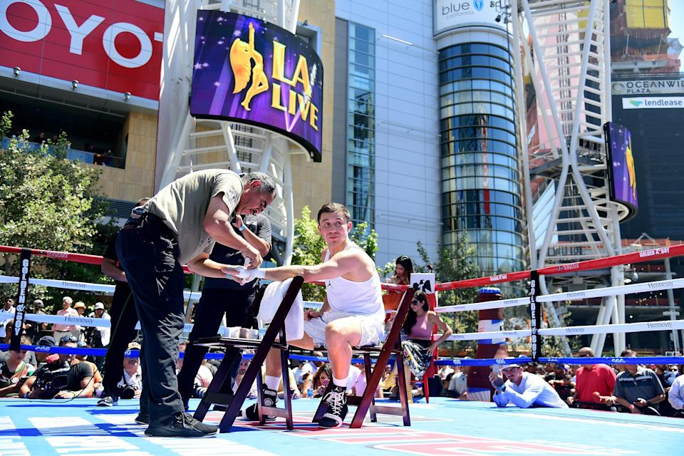 Trainer Abel Sanchez wraps Gennady Golovkin's hands prior to a workout at Microsoft Square at LA Live in Los Angeles last year. (Getty Images)