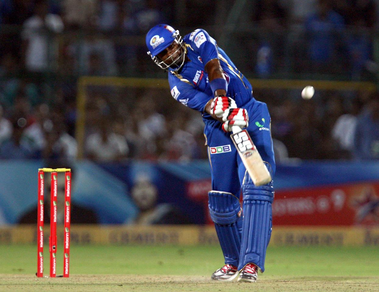 Mumbai Indians batsman Kieron Pollard in action during the CLT20 match against Rajasthan Royals at Sawai Mansingh Stadium, Jaipur on Sept. 21, 2013. (Photo: IANS)