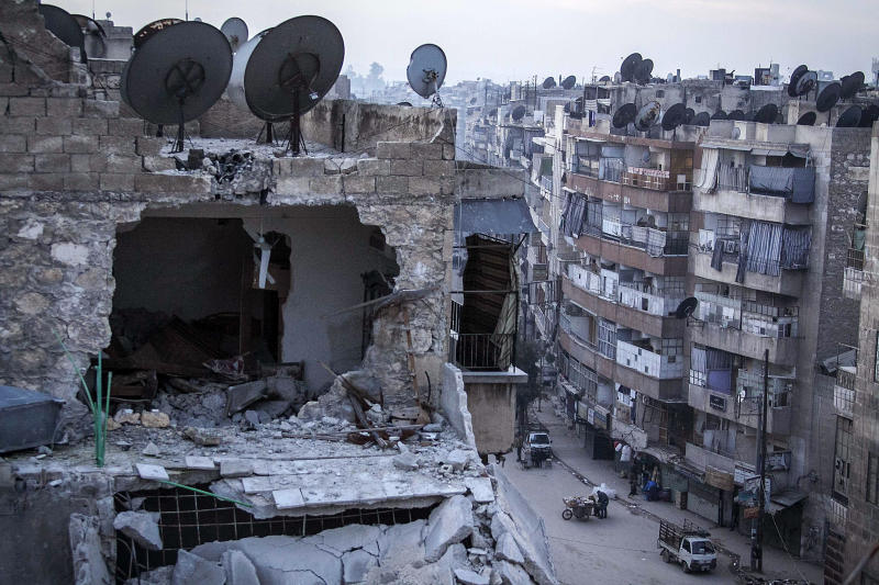 In this Thursday, Nov. 29, 2012 photo, a destroyed building is seen in Aleppo, Syria, after airstrikes targeted the area. (AP Photo/Narciso Contreras)
