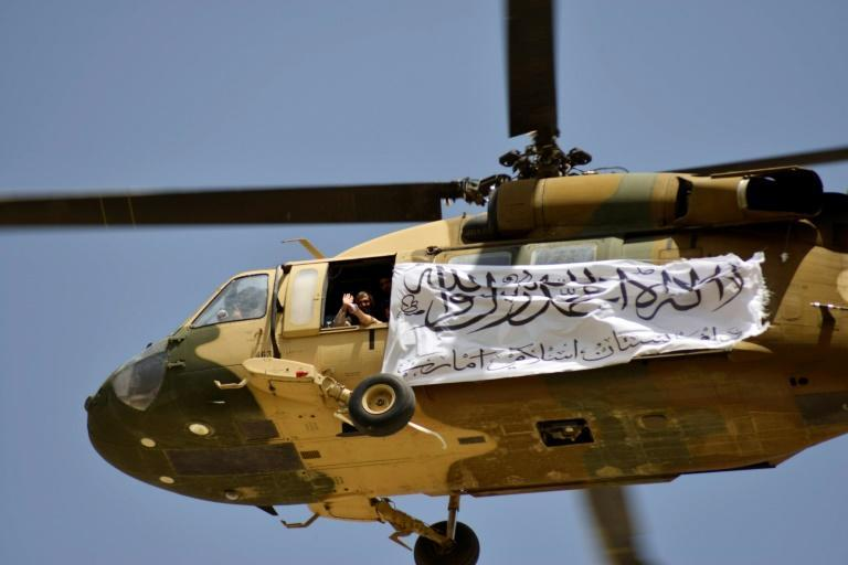 The Taliban flew a helicopter over Kandahar as they celebrated their victory (AFP/JAVED TANVEER)