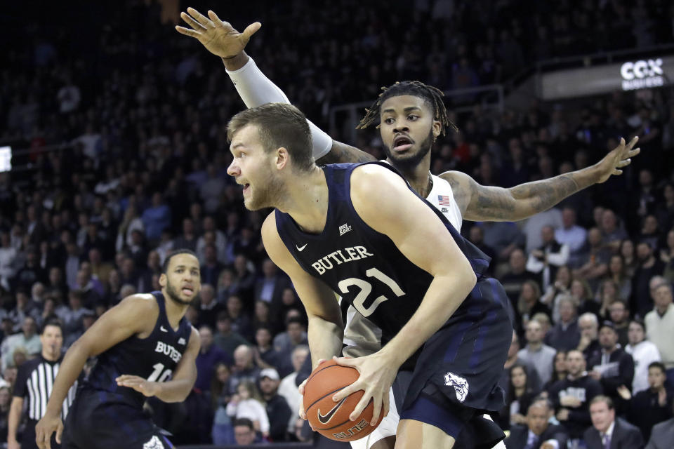 Butler center Derrik Smits (21) looks for an outlet as Providence center Nate Watson defends during the first half of an NCAA college basketball game Friday, Jan. 10, 2020, in Providence, R.I. (AP Photo/Elise Amendola)