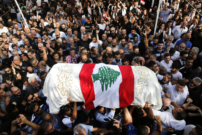 Mourners and relatives of Alaa Abu Fakher, who was killed by a Lebanese soldier in Tuesday night protests south of Beirut, carry his coffin during his funeral procession, in Choueifat neighborhood, Lebanon, Thursday, Nov. 14, 2019. For nearly a month, the popular protests engulfing Lebanon have been startlingly peaceful. But the shooting death of Fakher, a 38-year-old father by a soldier, the first such fatality in the unrest, points to the dangerous, dark turn the country could be heading into. (AP Photo/Hussein Malla)