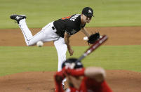 Miami Marlins starting pitcher Trevor Richards throws to a Washington Nationals batter during the first inning of a baseball game Saturday, July 28, 2018, in Miami. (AP Photo/Brynn Anderson)