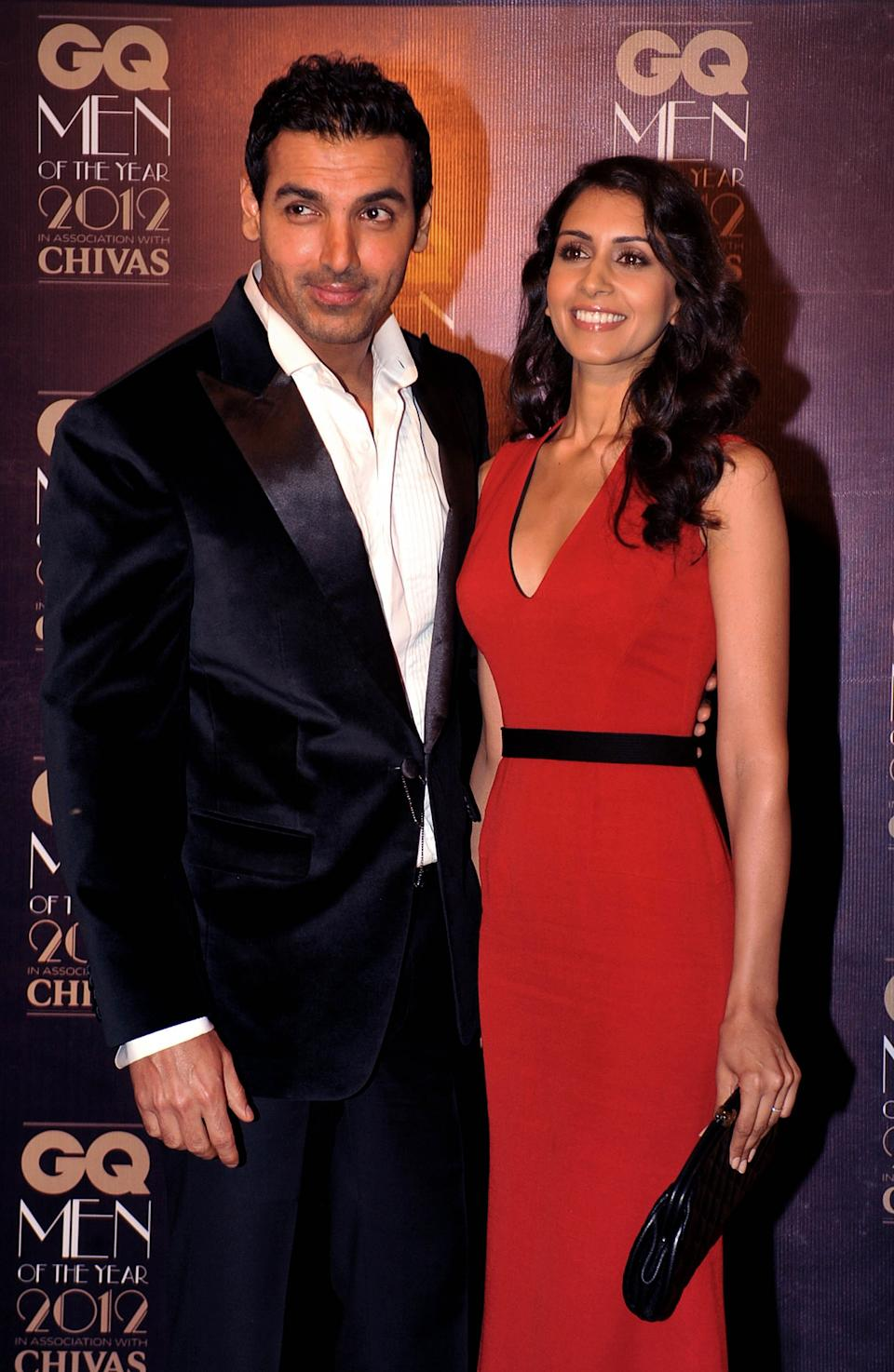 Indian Bollywood film actor John Abraham (L), with girlfriend Priya Runchal, received the Most Stylish Man award during the 'GQ Men of the Year Awards 2012' in Mumbai on September 30, 2012.   AFP PHOTO        (Photo credit should read STR/AFP/GettyImages)