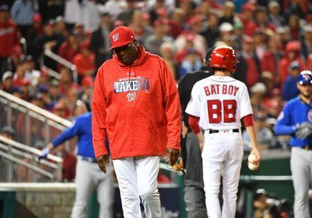 FILE PHOTO: Washington Nationals manager Dusty Baker (12) walks off the field in the fifth inning during game five of the 2017 NLDS playoff baseball series against the Chicago Cubs at Nationals Park, October 12, 2017; Washington, DC, USA. Mandatory Credit: Brad Mills-USA TODAY Sports