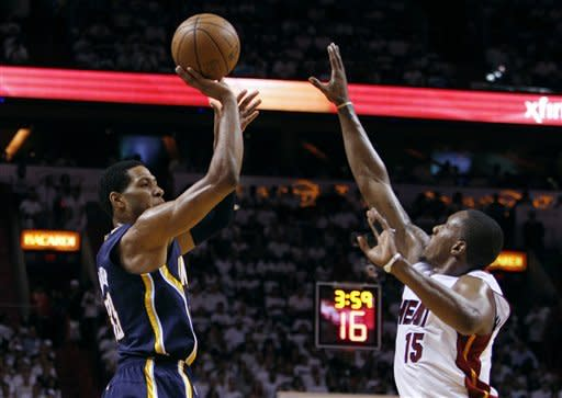 Indiana Pacers' Danny Granger (33) shoots over Miami Heat's Mario Chalmers (15) during the first half of Game 5 of an NBA basketball Eastern Conference semifinal playoff series, in Miami on Tuesday, May 22, 2012. (AP Photo/Lynne Sladky)