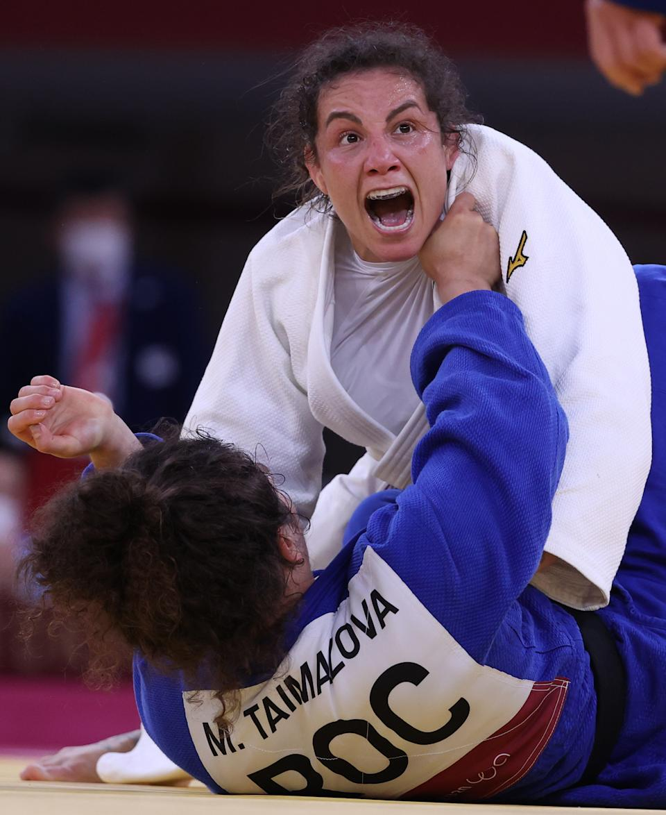 <p>Spain's Maria Bernabeu (top) and Russia's Madina Taimazova compete in ladies' -70kg Elimination Round of 32 judo bout at the Nippon Budokan indoor arena during the 2020 Summer Olympic Games. Stanislav Krasilnikov/TASS (Photo by Stanislav Krasilnikov\TASS via Getty Images)</p>