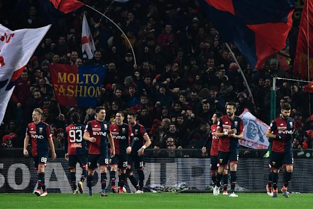 Time to celebrate: Genoa's players after beating Inter Milan (AFP Photo/MIGUEL MEDINA)
