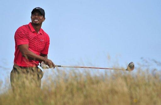 Tiger Woods of the US watches his shot from the 11th tee during his final round