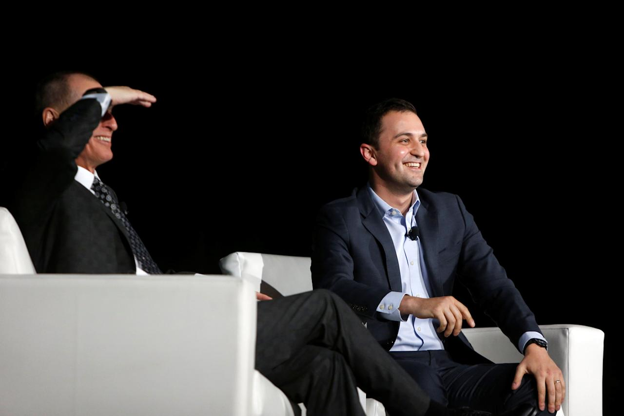 Gary Shapiro (L), president/CEO of the Consumer Technology Association, and Lyft co-founder and president John Zimmer look out into the audience at a Leaders in Technology dinner during the 2018 CES in Las Vegas, Nevada, U.S. January 10, 2018. REUTERS/Steve Marcus