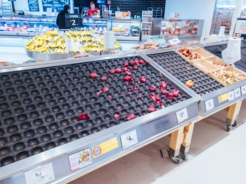 MELBOURNE, AUSTRALIA - JULY 8, 2020: As Melbourne shuts down for a second time, empty fruit and vegetable shelves become common in Australian supermarkets. This is due to the rapid rises in cases of Coronavirus or COVID-19.