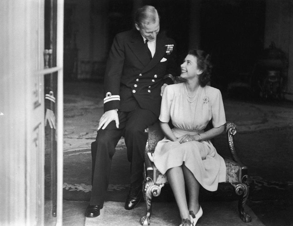 <p>Princess Elizabeth (later Queen Elizabeth II) and her fiancé, Philip Mountbatten, at Buckingham Palace, after their engagement was announced on July 10th, 1947. Their courtship charmed a nation desperately in need of romance following World War II. </p>