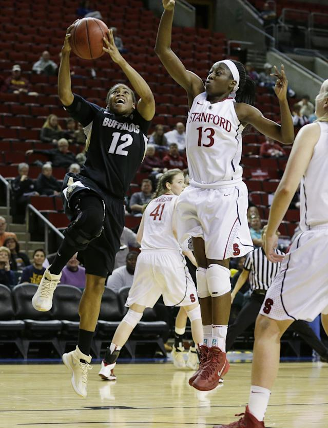 Colorado's Ashley Wilson (12) shoots against the defense of Stanford's Chiney Ogwumike (13) in the first half of an NCAA college basketball game in the second round of the Pac-12 women's tournamenton Friday, March 7, 2014, in Seattle. (AP Photo/Ted S. Warren)