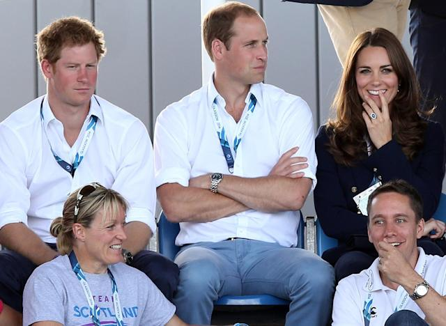 Britain's Kate Duchess of Cambridge, right, and Prince William, center, and Prince Harry, left, react as they watch the women's field hockey match between Wales and Scotland, during the Commonwealth Games Glasgow 2014, at the National Hockey Centre, Glasgow, Scotland, Monday July 28, 2014. (AP Photo/ Scott Heppell)