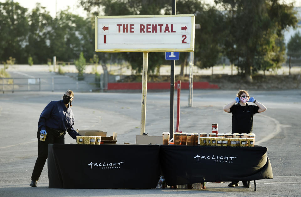 """Workers prepare to hand out concessions to drivers before an advance screening of the film """"The Rental"""" at Vineland Drive-In, Thursday, June 18, 2020, in City of Industry, Calif. (AP Photo/Chris Pizzello)"""