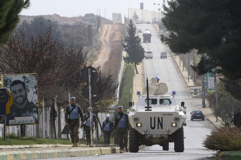 """Serbian U.N peacekeepers patrol the Lebanese side of the Lebanese-Israeli border in the southern village of Kfar Kila, Lebanon, Tuesday, Dec. 4, 2018. The Israeli military launched an operation on Tuesday to """"expose and thwart"""" tunnels it says were built by the Hezbollah militant group that stretch from Lebanon into northern Israel. (AP Photo/Mohammed Zaatari)"""
