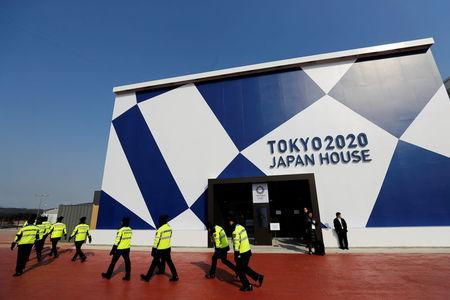 Security personnel pass by the Tokyo 2020 Japan House during a media preview in Gangneung, South Korea, February 8, 2018. REUTERS/Jorge Silva