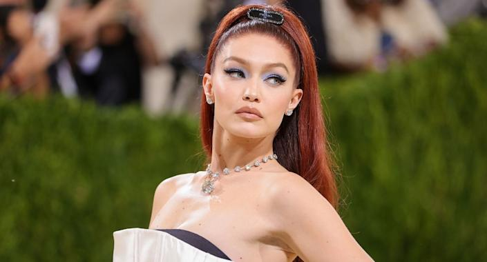 Gigi Hadid's makeup look at the 2021 Met Gala included a super affordable concealer by Maybelline. (Image via Getty Images)