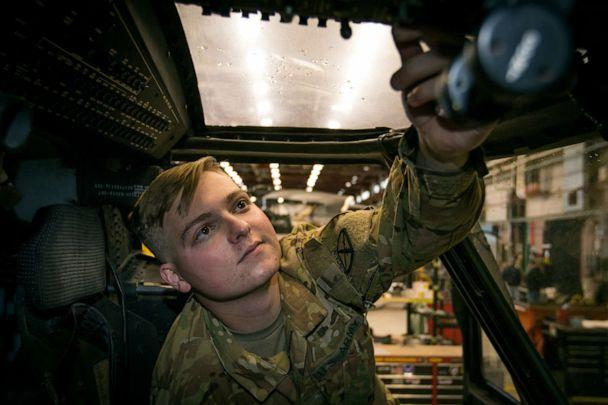 PHOTO: U.S. Army Pvt. Hunter Nines from Company A, 3rd General Support Aviation Battalion, 10th Combat Aviation Brigade inspects cockpit flight controls inside a UH-60M Blackhawk helicopter at Fort Drum, N.Y. on Oct. 4, 2019. (US Army)