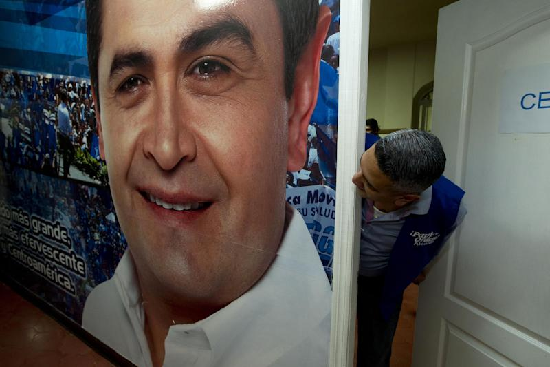 A poster of National Party presidential candidate Juan Orlando Hernandez covers a wall at his party's campaign headquarters in Tegucigalpa, Honduras, Thursday, Nov. 21, 2013. Honduras will hold general elections on Nov. 24. (AP Photo/Moises Castillo)