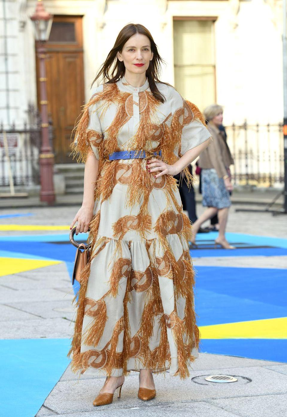 <p>The designer wore one of her own dresses to the Royal Academy Of Arts summer party.</p>