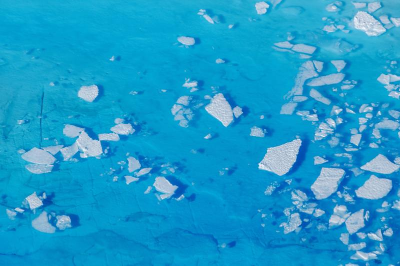 Chunks of ice float inside of meltwater pools on top of the Helheim glacier near Tasiilaq, Greenland. Source: Reuters