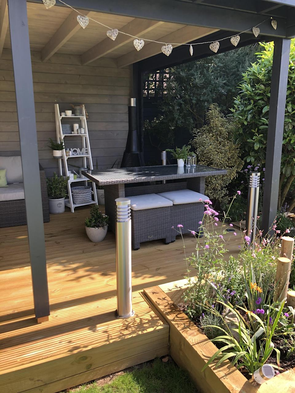 The couple saved money by reusing their current garden furniture. (Supplied latestdeals.co.uk)