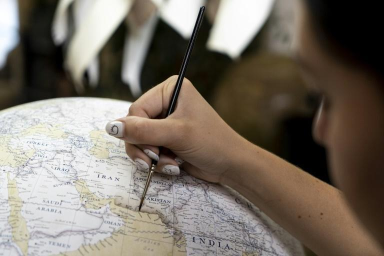 After the paper is delicately applied to the globe, it undergoes further rounds of watercolour painting before it is finally sealed with a gloss or matte finish