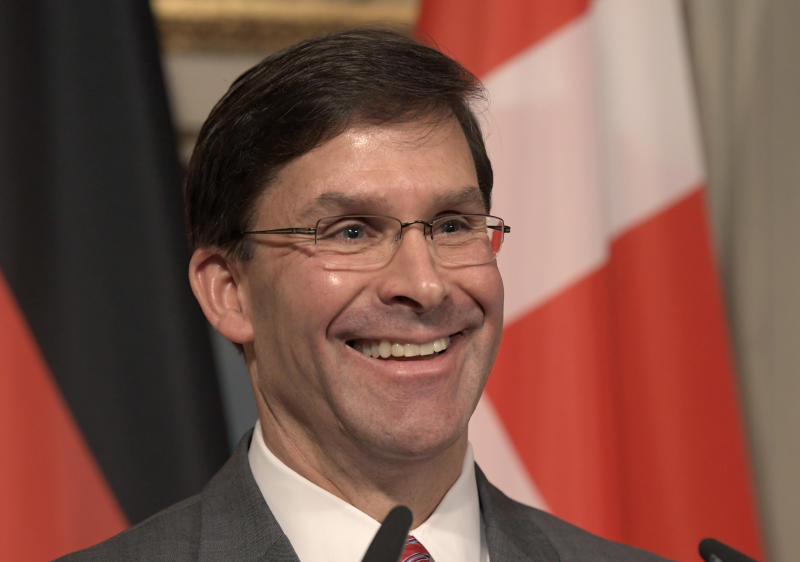 U.S. Secretary for Defense Mark Esper speaks during a press conference on the first day of the Munich Security Conference in Munich, Germany, Friday, Feb. 14, 2020. (AP Photo/Jens Meyer)b