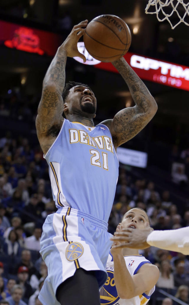 Denver Nuggets' Wilson Chandler (21) shoots over Golden State Warriors' Stephen Curry during the first half of an NBA basketball game Wednesday, Jan. 15, 2014, in Oakland, Calif. (AP Photo/Ben Margot)